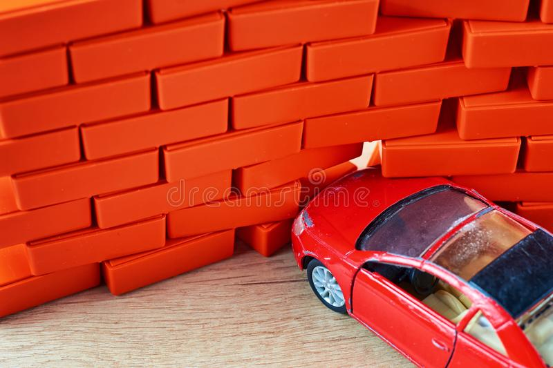 Car crash accident. Automobile hit a brick wall. A car insurance concept. Car crash accident. Automobile hit a brick wall. Car insurance concept royalty free stock photo