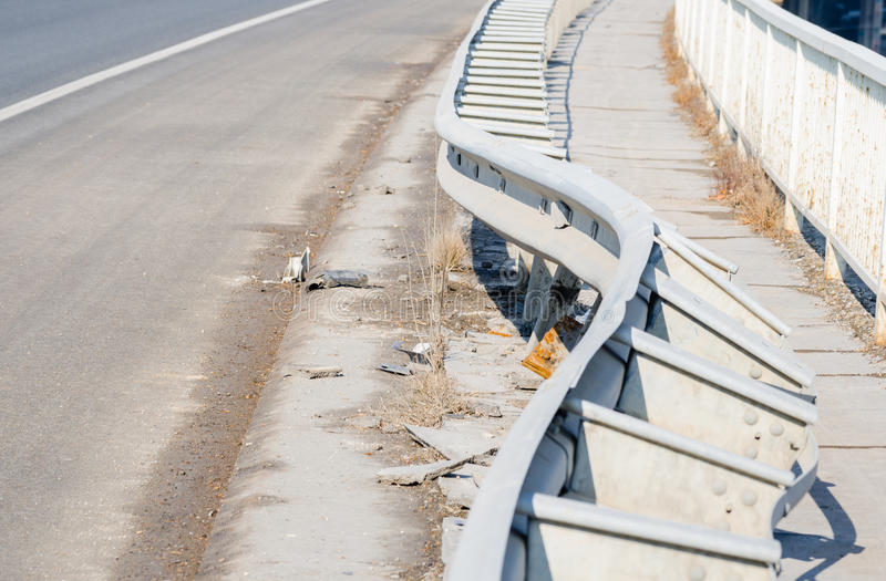 Car crash accident site. Damaged fence on the bridge from car crash accident. Selective focus stock image