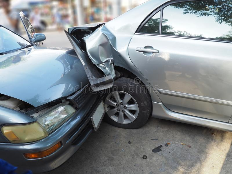 Car crash accident on street with wreck and damaged automobiles. Accident caused by negligence And lack of ability to drive. Due t stock photography