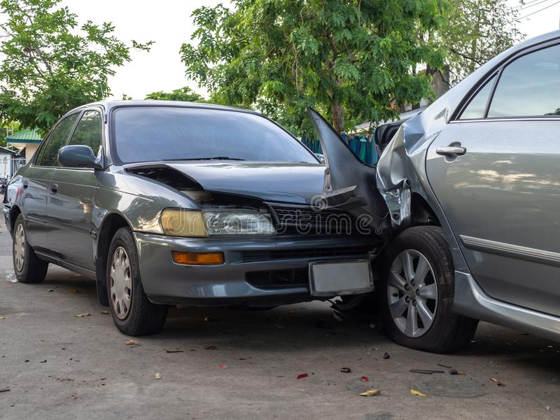 Car crash accident on street with wreck and damaged automobiles. Accident caused by negligence And lack of ability to drive. Due t. O illness stock photography
