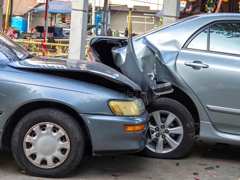 Car crash accident on street with wreck and damaged automobiles. Accident caused by negligence And lack of ability to drive. Due t. O illness royalty free stock images