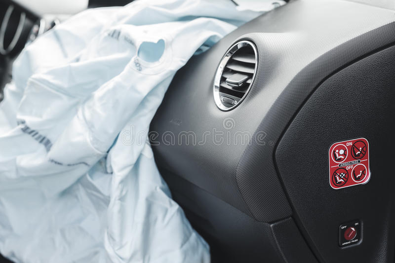Car Crash air bag, blue, inscription airbag. The airbag is fired during the accident. Blue. The inscription airbag and the sticker on the panel stock images