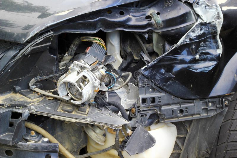 Car crash. Crashed car close up. The front part is severely damaged royalty free stock photo