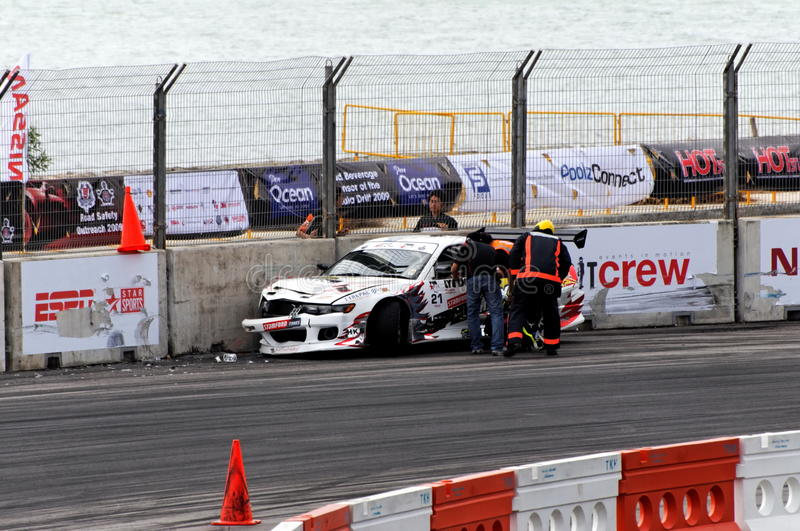 Car crash during Formula Drift Singapore 2009. Fireman and race marshal rushed to check on Felix, who crashed his car during Formula Drift Singapore 2009 Pro-Am royalty free stock photography