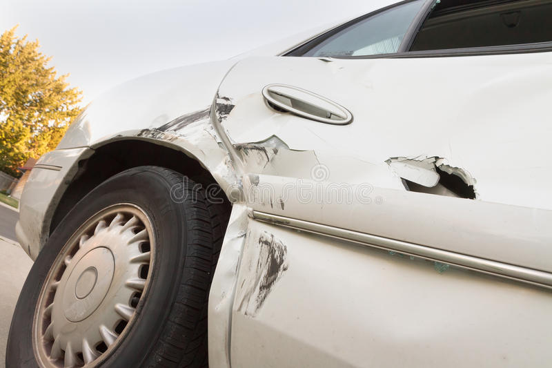 Car crash. Crash that tore up a car fairly well causing a huge dent stock image