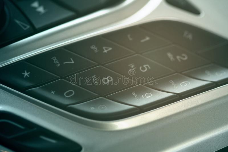 Car dashboard dial pad beside audio control buttons royalty free stock images