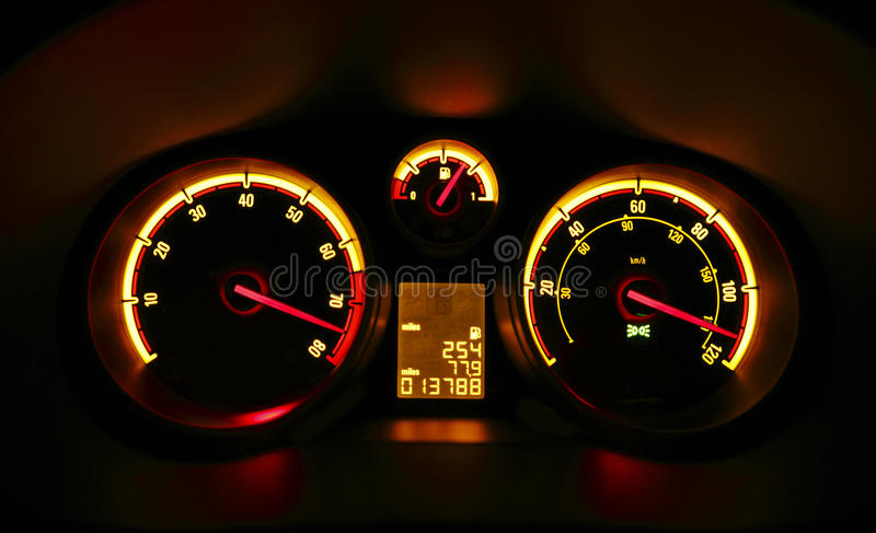 Car dashboard dials at night royalty free stock photography