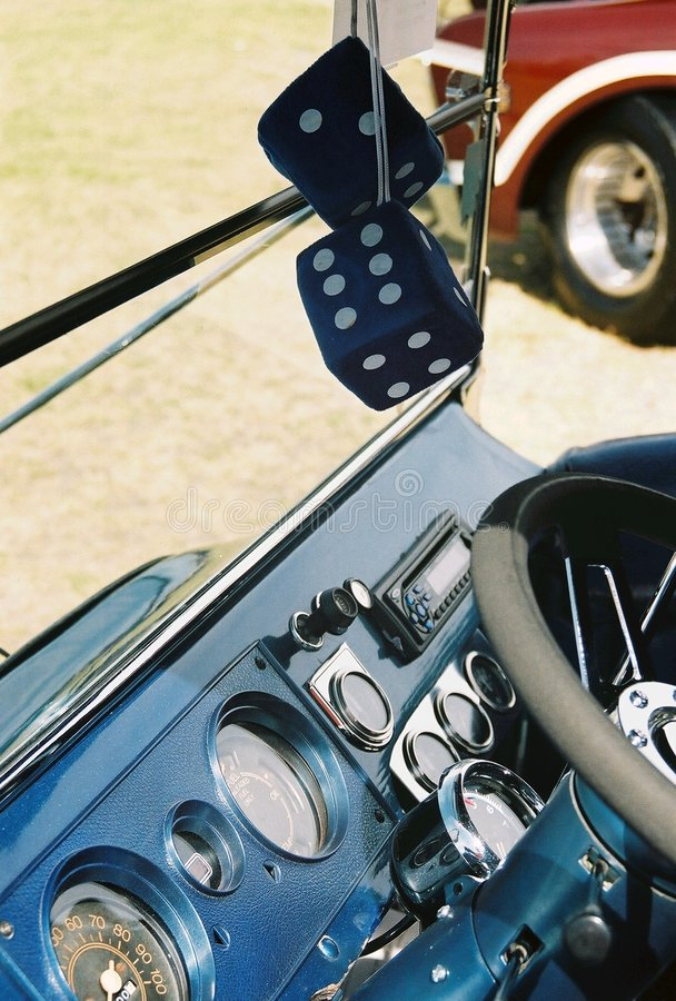 Car dashboard with fuzzy dice stock image