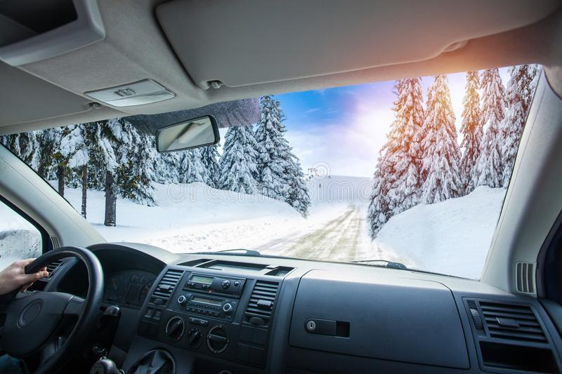 Car dashboard and steering wheel inside of car. Winter landscape. Travel concepte royalty free stock photography