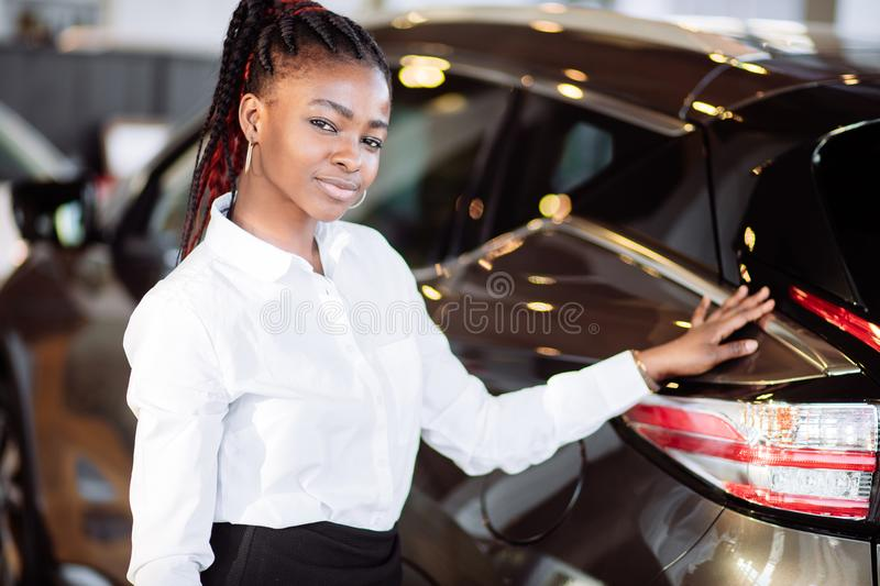 Car dealer woman. Auto dealership and rental concept royalty free stock image