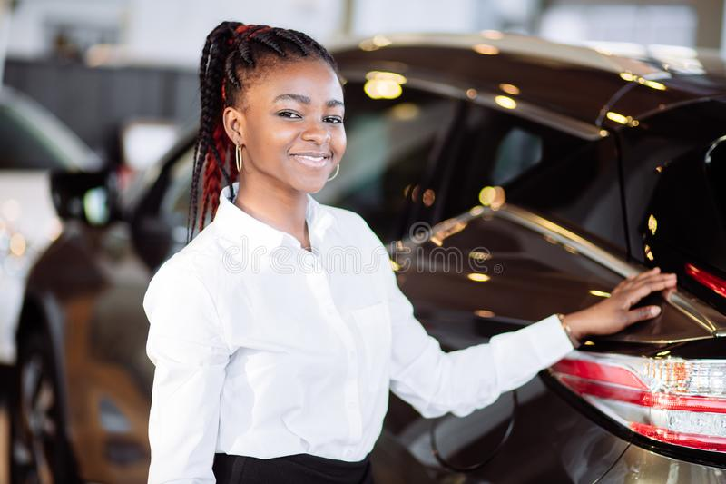 Car dealer woman. Auto dealership and rental concept. Background royalty free stock photography