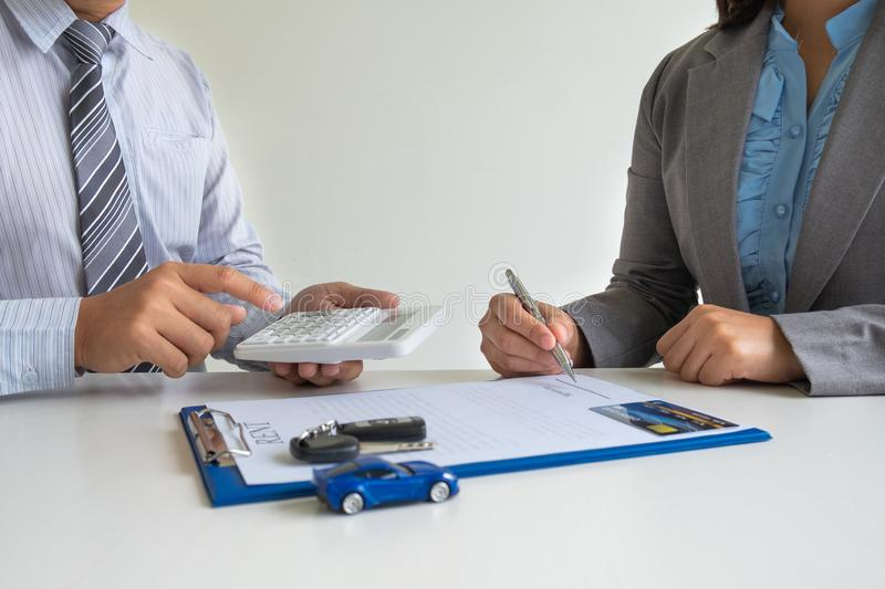 Car dealership provides advice about insurance details and car rental information and delivers the keys after signing the rental. Contract stock photos