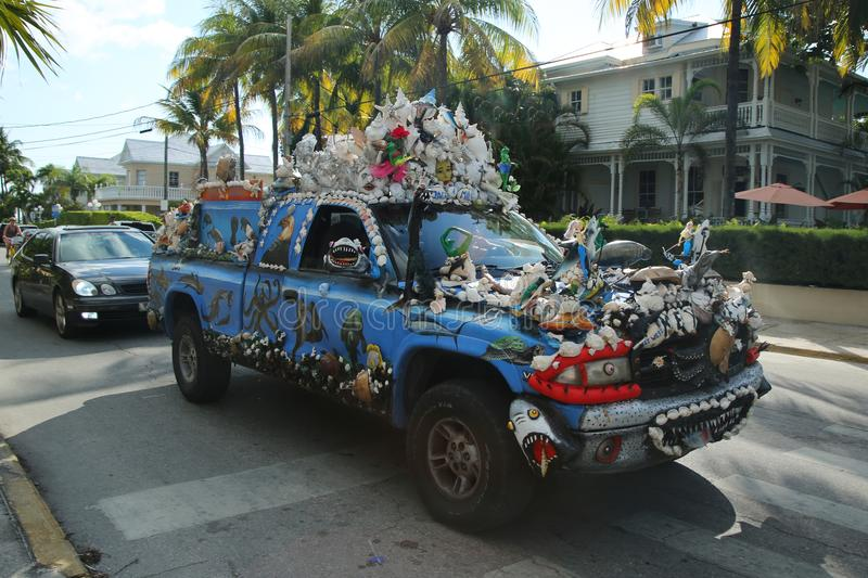 Car decorated with shells in Key West, Florida, USA. KEY WEST, FLORIDA - MAY 29, 2016: Car decorated with shells in Key West, Florida, USA. Key West is an island stock photo