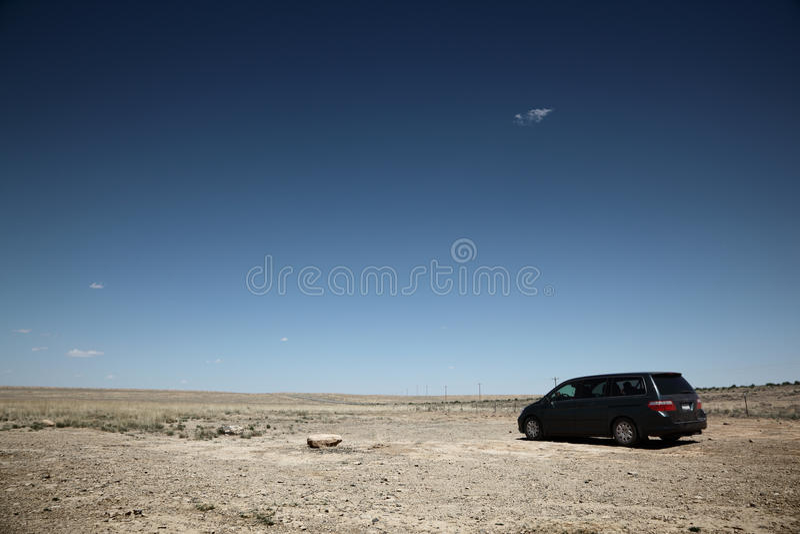 Car in desert. Under blue sky royalty free stock photos