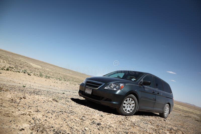 Car in desert. Under blue sky stock photo