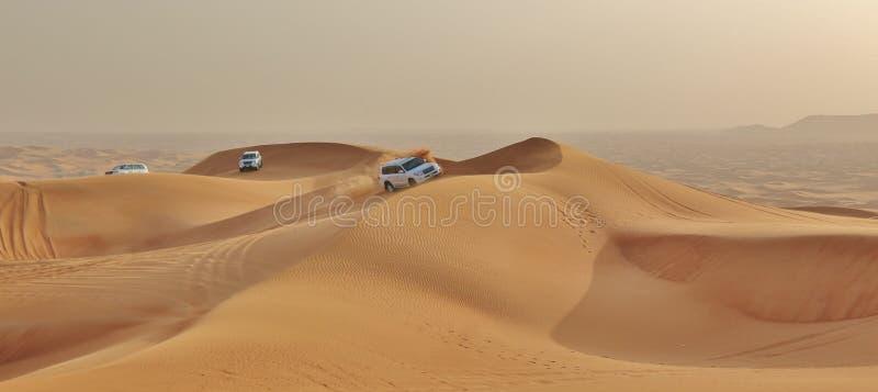 Car in desert stock image