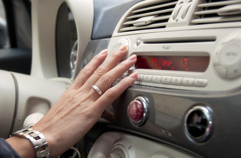 Car design. The design of a modern carn and a hand changing the radio station stock photo