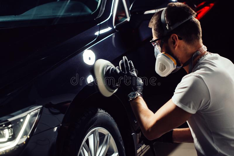 Car Detailing Man With Orbital Polisher In Auto Repair Shop Selective Focus Stock Image Image Of Black Auto 105652859