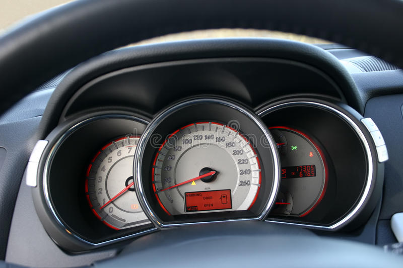 Car dials. Speedometer and tachometer with additional instruments stock photography