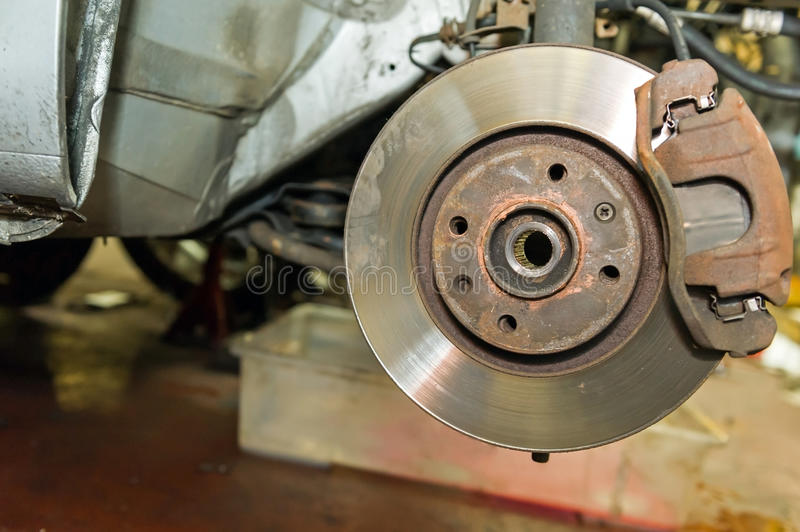 Car disc brakes. Details of car disc brakes servicing royalty free stock photography