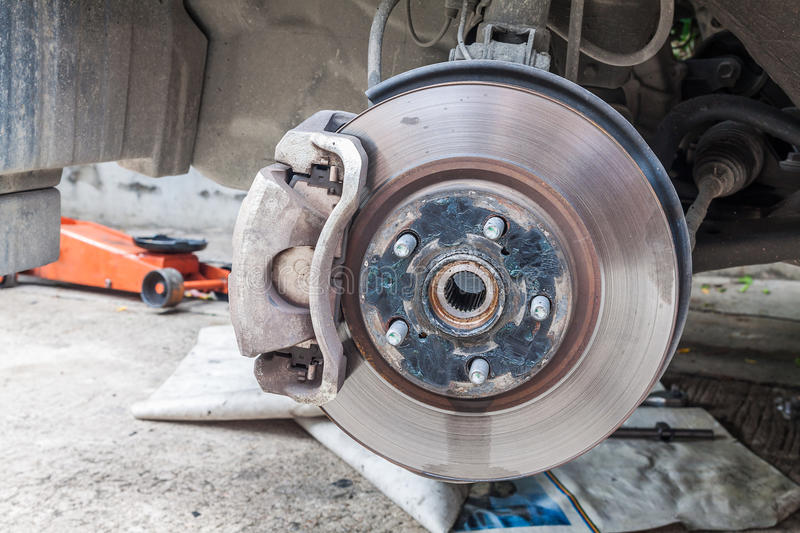 Car disc brakes fixing. Closeup photo of car disc brakes fixing outdoor stock photo
