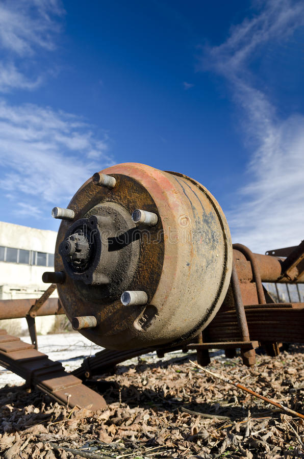 Car disc break with rusty bolts. On the blue sky royalty free stock images