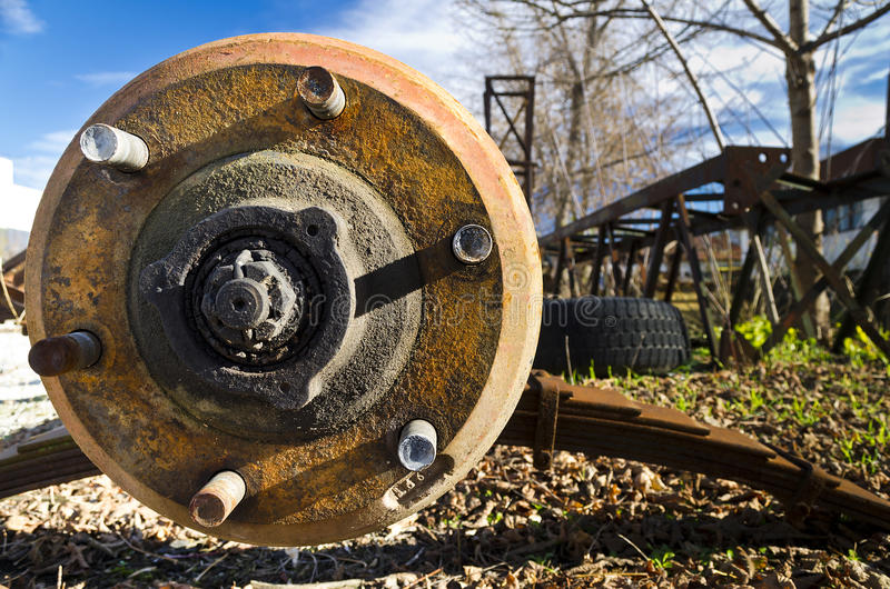 Car disc break with rusty bolts. On the blue sky stock images