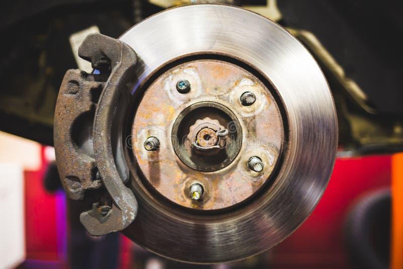 Car disk brakes repair service performed stock image