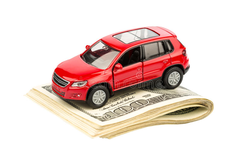 Car on dollar bills. A car is on dollar bills. costs for the purchase of automobiles, gasoline, insurance and other car costs royalty free stock photography