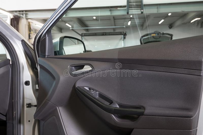 Car door before and after dry. Cleaning and interior washing stock photo