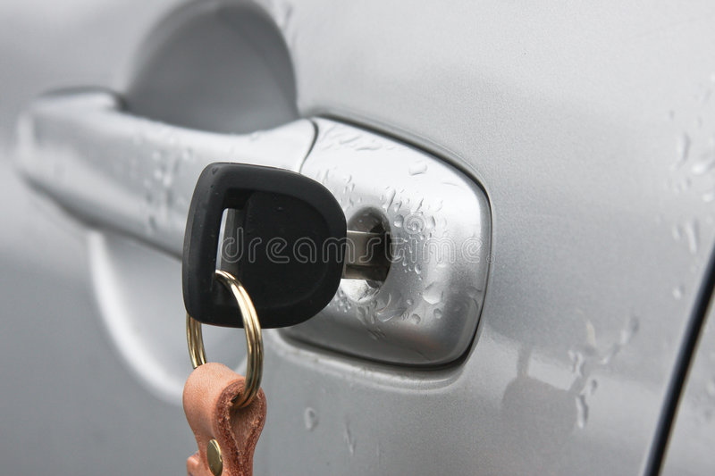 Car door handle with a key stock images
