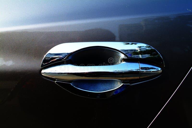 Car door handle. Sliver door handle in limousine royalty free stock photo