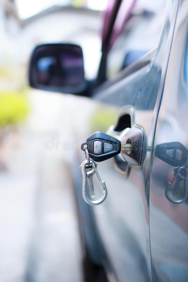 Car door and key. Automobile automotive car doo door entering key royalty free stock photo