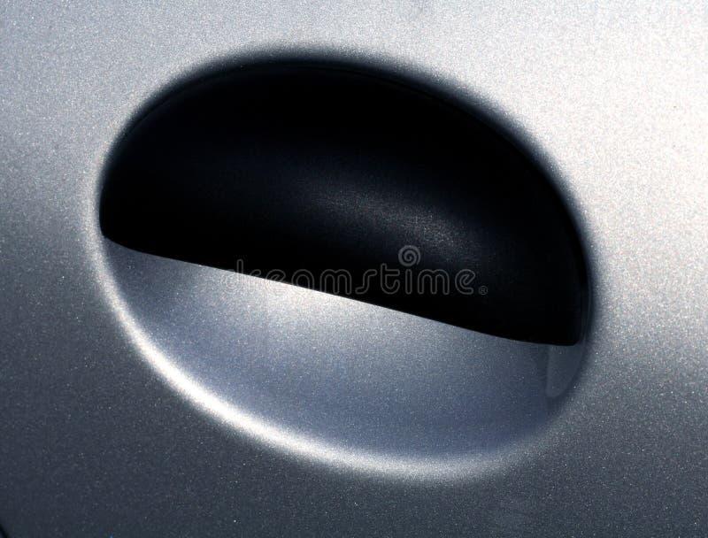 Car door lever. Design of a silver car door lever stock images