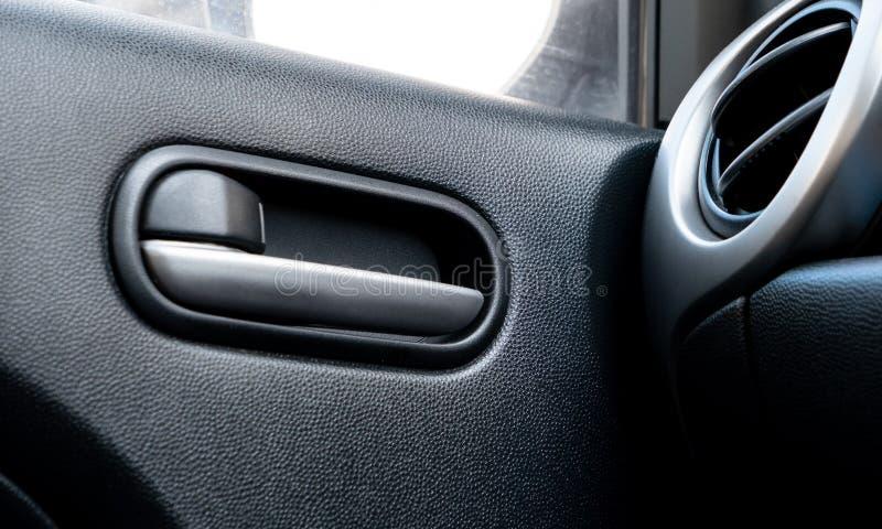 Car door lock lever in driver place. Car door lock lever inside driver place royalty free stock photo