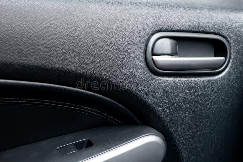 Car door lock lever in driver place. Car door lock lever inside driver place stock photography