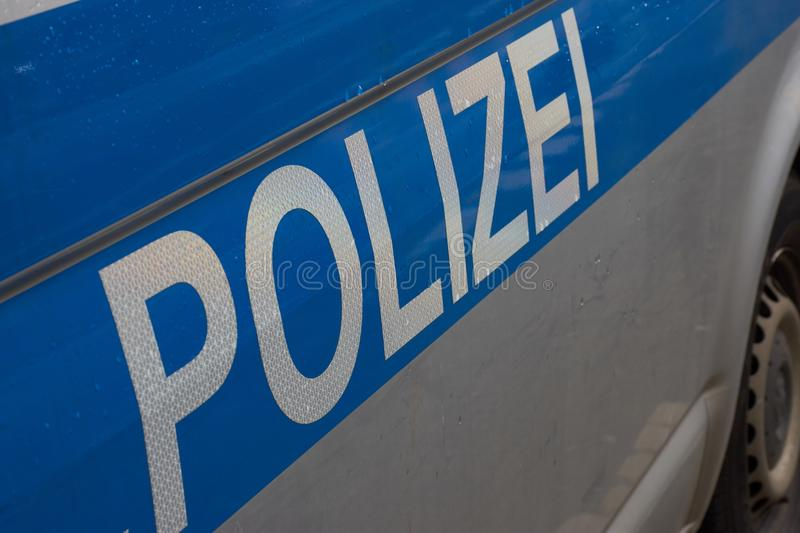 German word for police on a police car. On a car door written on a police car: the word `Polizei` which is German for police stock photography