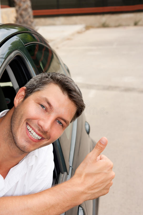Car driver man. Car driving male in new car royalty free stock photo