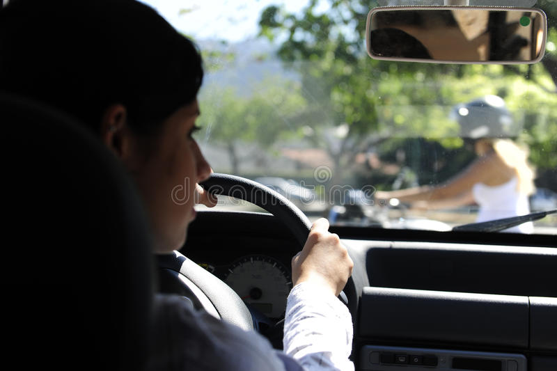 Car driver nearly colliding with bike royalty free stock images