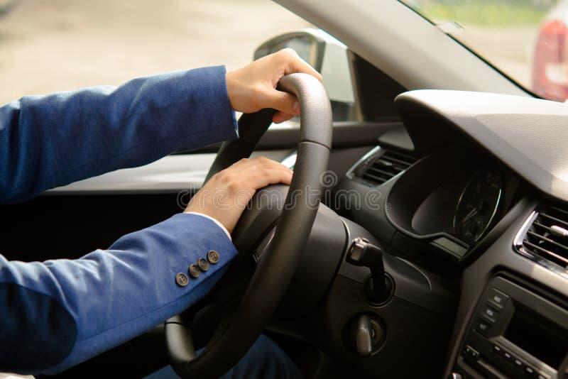 Car driver sitting behind the wheel, signaling stock image