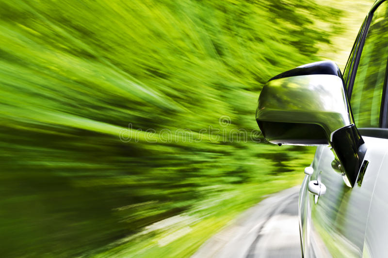 Car driving. Motion blur shot of a car driving in a curve stock photos