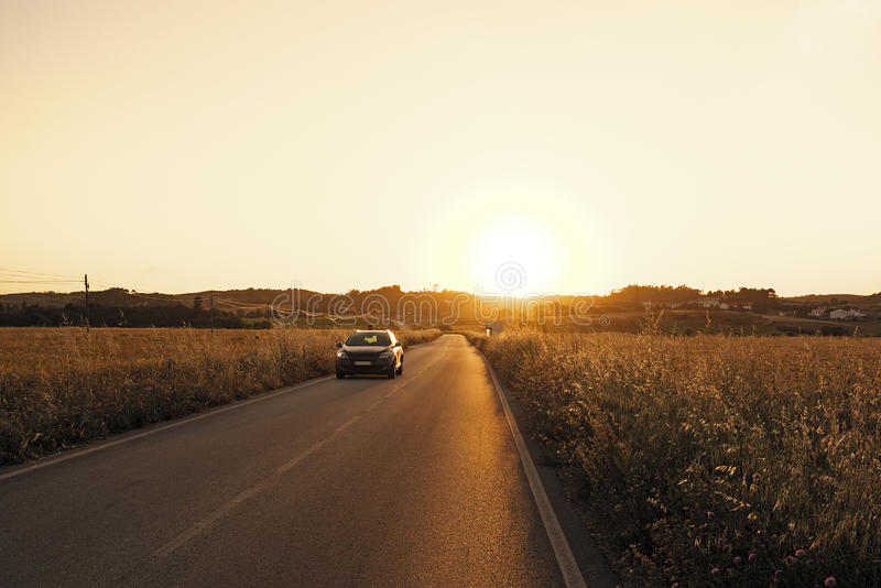 Download Car Driving Through The Corn Fields At Twilight Stock Photo - Image: 31499378