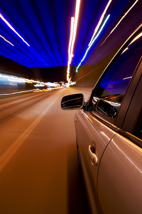 Car driving fast. In the night city stock images