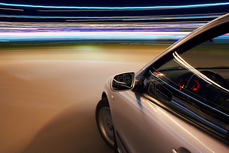 Car driving fast. In the night stock image