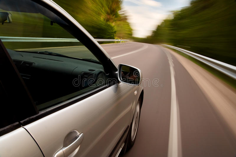 Car driving fast. On a country road stock photography