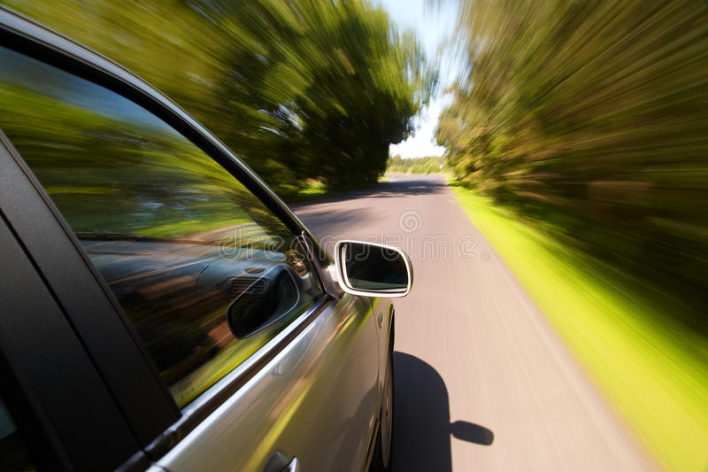 Car driving fast. On a country road royalty free stock image