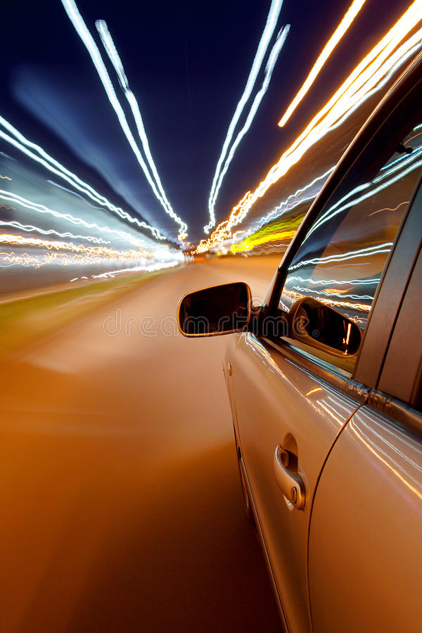 Car driving fast. In the night city royalty free stock photo