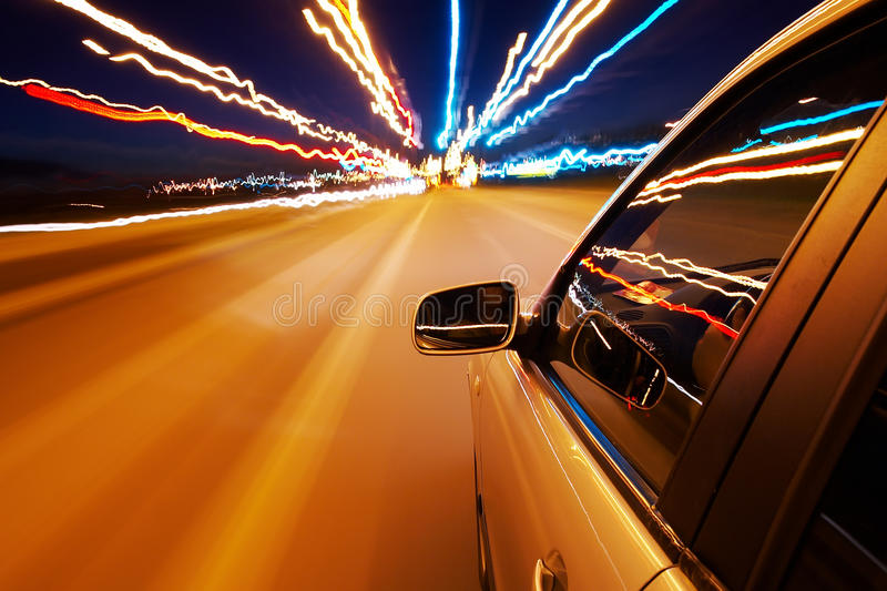 Car driving fast. In the night city royalty free stock images