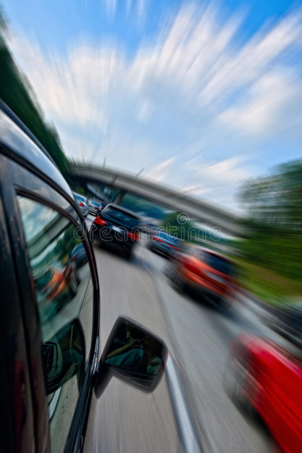 Car driving fast. On highway road stock photo