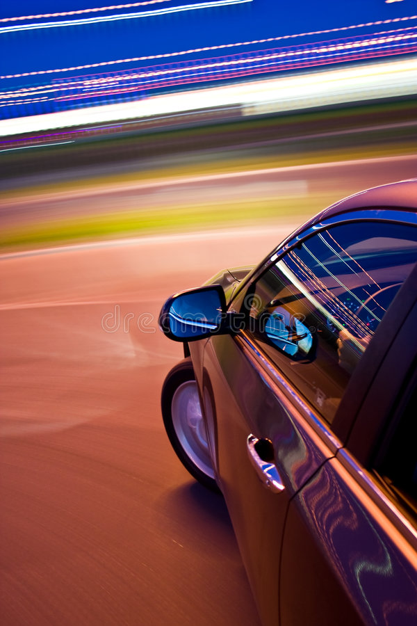 Car driving fast. In the night royalty free stock photos
